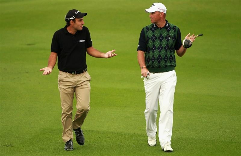 BAHRAIN, BAHRAIN - JANUARY 28:  Edoardo Molinari of Italy (left) and Thomas Bjorn of Denmark share a joke on the 14th hole during the second round of the Volvo Golf Champions at The Royal Golf Club on January 28, 2011 in Bahrain, Bahrain.  (Photo by Andrew Redington/Getty Images)