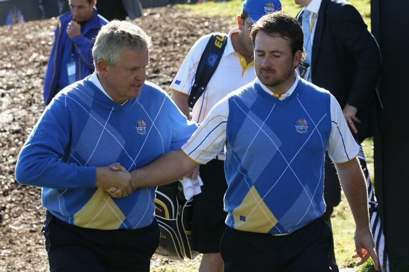 NEWPORT, WALES - OCTOBER 04:  The European Team Captain Colin Montgomerie encourages Graeme McDowell in the singles matches during the 2010 Ryder Cup at the Celtic Manor Resort on October 4, 2010 in Newport, Wales.  (Photo by David Cannon/Getty Images)