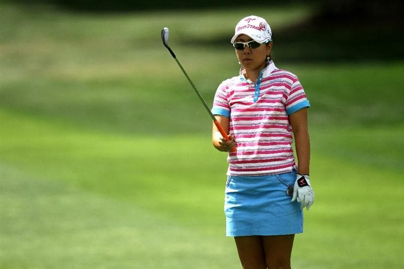 RANCHO MIRAGE,CA - APRIL 2:  Mika Miyazato of Japan lines up a shot on the ninth hole during the third round of the Kraft Nabisco Championship at Mission Hills Country Club on April 2, 2011 in Rancho Mirage, California.  (Photo by Stephen Dunn/Getty Images)