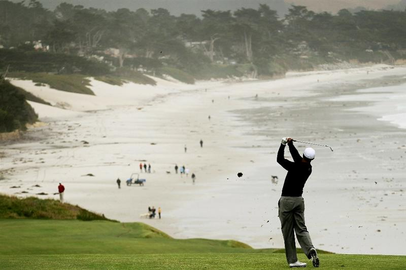 PEBBLE BEACH, CA - JUNE 15:  Tiger Woods hits a shot during a practice round prior to the start of the 110th U.S. Open at Pebble Beach Golf Links on June 15, 2010 in Pebble Beach, California.  (Photo by Stephen Dunn/Getty Images)