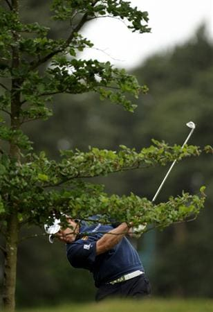 VIRGINIA WATER, ENGLAND - MAY 29:  Lee Westwood of England hits his 2nd shot on the 8th hole during the final round of the BMW PGA Championship  at the Wentworth Club on May 29, 2011 in Virginia Water, England.  (Photo by Ross Kinnaird/Getty Images)