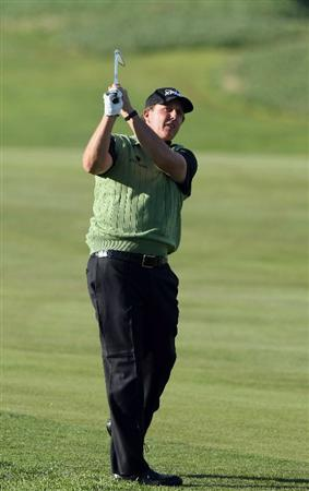 LA JOLLA, CA- JANUARY 26:  Phil Mickelson hits his approach shot off the 17th fairway during the Pro-Am at the Farmers Insurance Open at Torrey Pines on January 26, 2011 in La Jolla, California. (Photo by Donald Miralle/Getty Images)