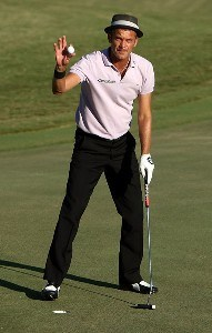 Jesper Parnevik of Sweden waves to the crowd after making birdie on the ninth hole during the first round of the Valero Texas Open at La Cantera Golf Club October 4, 2007 in San Antonio, Texas. PGA TOUR - 2007 Valero Texas Open - First RoundPhoto by Jonathan Ferrey/WireImage.com