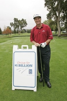 Peter Jacobsen poses with the persimmon driver used to promote the 'Drive To A Billion' campaign Wednesday October 26, during the 2005 Schwab Cup Championship at Sonoma Golf Club - Sonoma, California.Photo by Chris Condon/PGA TOUR/WireImage.com
