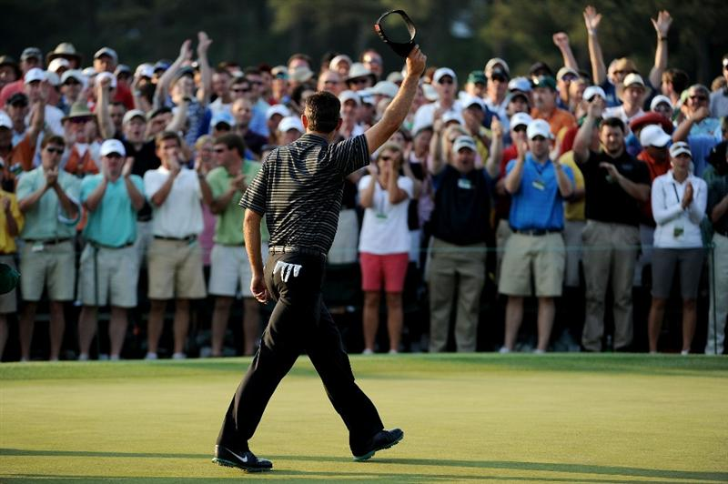 AUGUSTA, GA - APRIL 10:  Charl Schwartzel of South Africa celebrates his two-stroke victory on the 18th green as patrons look on during the final round of the 2011 Masters Tournament at Augusta National Golf Club on April 10, 2011 in Augusta, Georgia.  (Photo by Harry How/Getty Images)