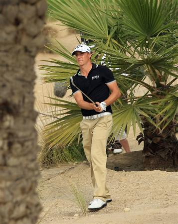 BAHRAIN, BAHRAIN - JANUARY 27:  Alexander Noren of Sweden hits his second shot on the 18th hole during the first round of the Volvo Golf Champions at The Royal Golf Club on January 27, 2011 in Bahrain, Bahrain.  (Photo by Andrew Redington/Getty Images)