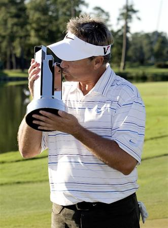 THE WOODLANDS, TX - OCTOBER 18:  John Cook kisses the winner's trophy after the final round of the 2009 Administaff Small Business Classic at The Woodlands Country Club on October 18, 2009 in The Woodlands, Texas.  (Photo by Bob Levey/Getty Images)