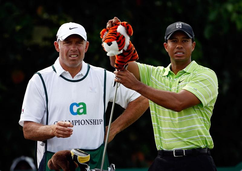 DORAL, FL - MARCH 14:  Tiger Woods pulls out his driver as caddie Steve Williams watches on the 2nd hole during the third round of the World Golf Championships-CA Championship on March 14, 2009 at the Doral Golf Resort and Spa in Miami, Florida.  (Photo by Jamie Squire/Getty Images)