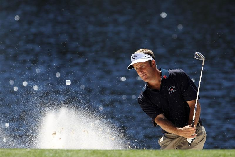 AUGUSTA, GA - APRIL 06:  Stuart Appleby of Australia plays a bunker shot during the Par 3 Contest prior to the 2011 Masters Tournament at Augusta National Golf Club on April 6, 2011 in Augusta, Georgia.  (Photo by Andrew Redington/Getty Images)
