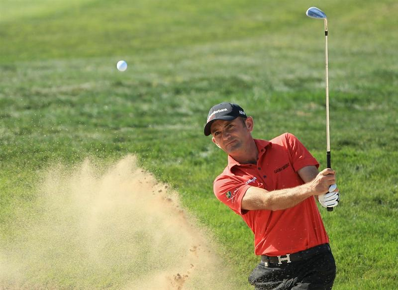 DOHA, QATAR - FEBRUARY 04:  Markus Brier of Austria plays a bunker shot on the first hole during the second round of the Commercialbank Qatar Masters held at Doha Golf Club on February 4, 2011 in Doha, Qatar.  (Photo by Andrew Redington/Getty Images)
