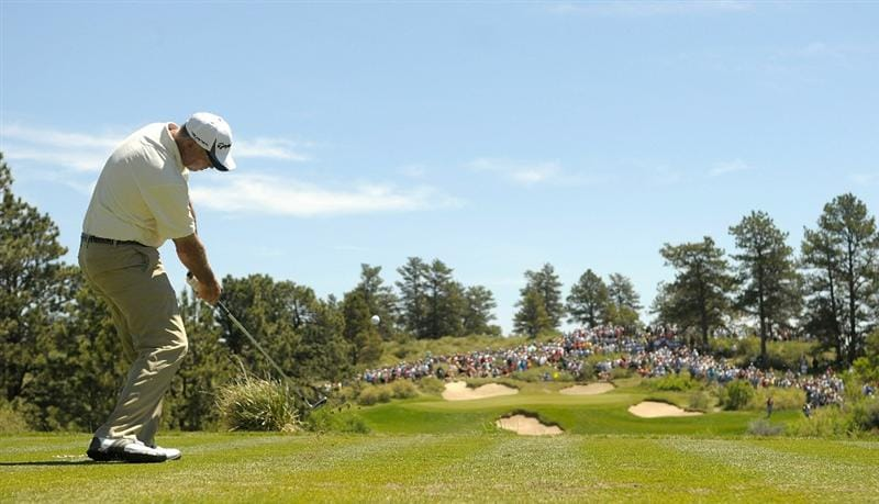 PARKER, CO. - MAY 29: Tom Lehman tees off the par three second hole during the third round of the Senior PGA Championship at the Colorado Golf Club on May 29, 2010 in Parker, Colorado.  (Photo by Marc Feldman/Getty Images)