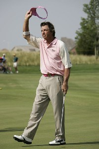 Dana Quigley acknowledges the crowd after finishing his third and final round of the Greater Kansas City Golf Classic at the Nicklaus Golf Club at LionsGate in Overland Park, Kansas on July 2, 2006.Photo by G. Newman Lowrance/WireImage.com