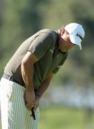 LA JOLLA, CA - JANUARY 29:  Phil Mickelson reacts to a missed birdie putt on the 6th green during Round 3 of the Farmers Insurance Open at Torrey Pines on January 29, 2011 in La Jolla, California. (Photo by Donald Miralle/Getty Images)