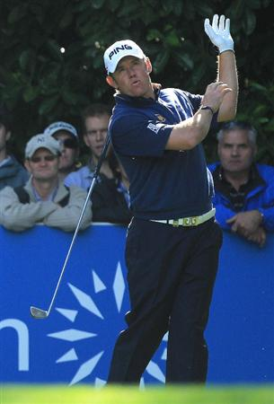 VIRGINIA WATER, ENGLAND - MAY 29:  Lee Westwood of England reacts to a poor tee shot on the 16th hole during the final round of the BMW PGA Championship  at the Wentworth Club on May 29, 2011 in Virginia Water, England.  (Photo by David Cannon/Getty Images)
