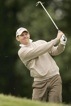 Stephen Gallacher watches his approach shot during the rain delayed second round of the 2005 Deutsche Bank Players Championship at Gut Kaden Golf Club in Hamburg, Germany on July 23, 2005.Photo by Pete Fontaine/WireImage.com