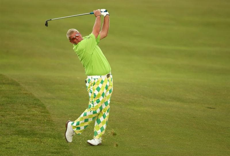 TURNBERRY, SCOTLAND - JULY 16:  John Daly of USA hits an approach shot on the 13th hole during round one of the 138th Open Championship on the Ailsa Course, Turnberry Golf Club on July 16, 2009 in Turnberry, Scotland.  (Photo by Richard Heathcote/Getty Images)