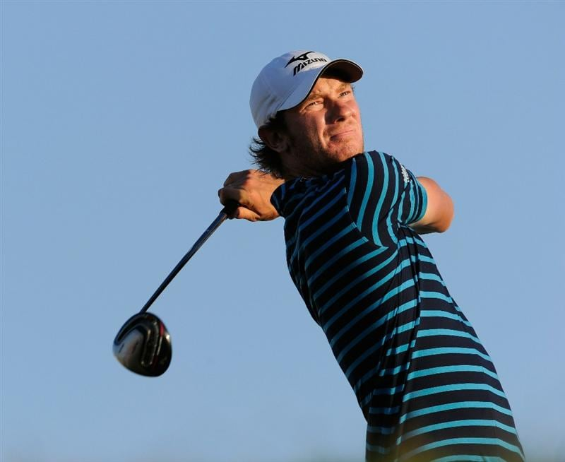 FARO, PORTUGAL - OCTOBER 14:  Chris Wood of England plays his tee shot on the 18th hole during the first round of the Portugal Masters at the Oceanico Victoria Golf Course on October 14, 2010 in Faro, Portugal.  (Photo by Stuart Franklin/Getty Images)