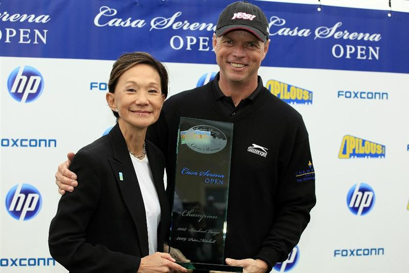 KUTNA HORA, CZECH REPUBLIC - SEPTEMBER 19:  Gary Wolstenholme of England is presented with the trophy by Maureen Chang, Casa Serena Founder after the final round of the Casa Serena Open played at Casa Serena Golf on September 19, 2010 in Kutna Hora, Czech Republic.  (Photo by Phil Inglis/Getty Images)