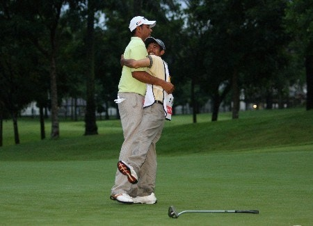 KUALA LUMPUR, MALAYSIA - MARCH 09:  Arjun Atwal of India celebrates with his caddie on the second play-off hole after winning the Maybank Malaysian Open held at the Kota Permai Golf & Country Club on March 9, 2008 in Kuala Lumpur, Malaysia.  (Photo by Andrew Redington/Getty Images)