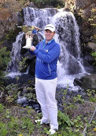 JEJU, SOUTH KOREA - APRIL 25:  Marcus Fraser of Australia poses with the trophy after winning the Ballantine's Championship at Pinx Golf Club on April 25, 2010 in Jeju, South Korea.  (Photo by Victor Fraile/Getty Images)