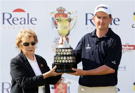 SEVILLE, SPAIN - MAY 04: Emma Villacieros, Preaidenta Real Federacion Espanola de Golf presents Peter Lawrie of Ireland with the winners trophy after the final round of the Open de Espana at the Real Club de Golf de Sevilla on May 4, 2008 in Seville, Spain.  (Photo by Ross Kinnaird/Getty Images)
