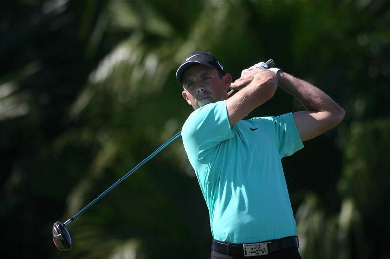 DORAL, FL - MARCH 13:  Charl Schwartzel of South Africa tees off on the eight tee box during round three of the 2010 WGC-CA Championship at the TPC Blue Monster at Doral on March 13, 2010 in Doral, Florida.  (Photo by Marc Serota/Getty Images)