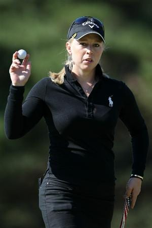 SHIMA, JAPAN - NOVEMBER 05:  Morgan Pressel of the United States acknowledges the crowd after sinking a putt on the green of the 12th hole during the round one of the Mizuno Classic at Kintetsu Kashikojima Country Club on November 5, 2010 in Shima, Mie, Japan.  (Photo by Kiyoshi Ota/Getty Images)
