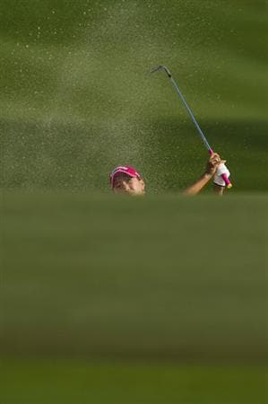 CHON BURI, THAILAND - FEBRUARY 21:  Momoko Ueda of Japan hits a bunker shot on the 18th green during the final round of the Honda PTT LPGA Thailand at Siam Country Club on February 21, 2010 in Chon Buri, Thailand.  (Photo by Victor Fraile/Getty Images)