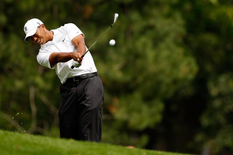 GRAND BLANC, MI - AUGUST 01:  Tiger Woods hits his second shot on the 9th hole during round three of the Buick Open at Warwick Hills Golf and Country Club on August 1, 2009 in Grand Blanc, Michigan.  (Photo by Chris Graythen/Getty Images)