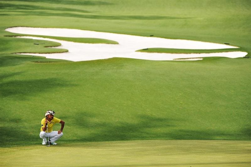 AUGUSTA, GA - APRIL 11:  Shingo Katayama of Japan lines up a putt on the tenth green during the third round of the 2009 Masters Tournament at Augusta National Golf Club on April 11, 2009 in Augusta, Georgia.  (Photo by Harry How/Getty Images)