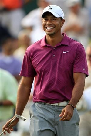PONTE VEDRA BEACH, FL - MAY 11:  Tiger Woods smiles during a practice round prior to the start of THE PLAYERS Championship held at THE PLAYERS Stadium course at TPC Sawgrass on May 11, 2011 in Ponte Vedra Beach, Florida.  (Photo by Streeter Lecka/Getty Images)