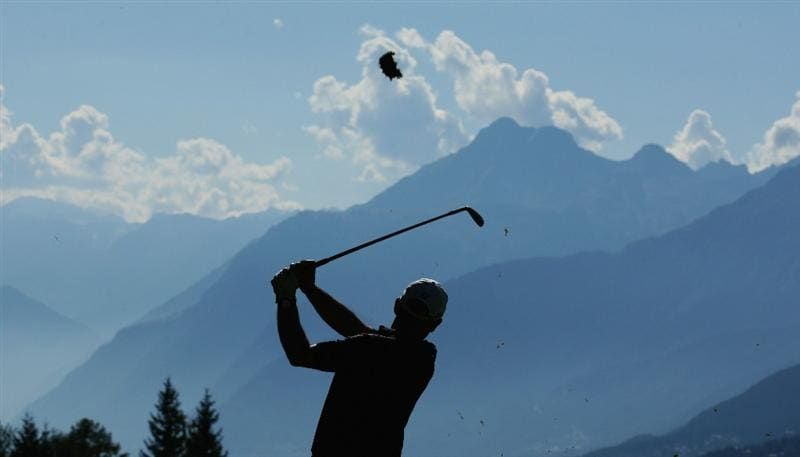 CRANS, SWITZERLAND - SEPTEMBER 03:  Paul McGinley of Ireland plays his second shot into the 14th green during the second round of The Omega European Masters at Crans-Sur-Sierre Golf Club on September 3, 2010 in Crans Montana, Switzerland.  (Photo by Warren Little/Getty Images)