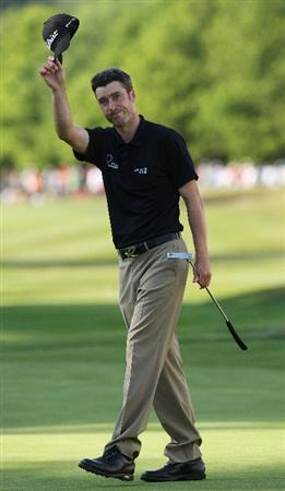 WENTWORTH, ENGLAND - MAY 24:  Ross Fisher of England acknowledges the crowd on the 18th green during the Final Round of the BMW PGA Championship at Wentworth on May 24, 2009 in Virginia Water, England.  (Photo by Andrew Redington/Getty Images)