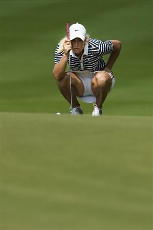 CHON BURI, THAILAND - FEBRUARY 19:  Suzann Pettersen of Norway lines up a put on the 10th green during round two of the Honda LPGA Thailand at the Siam Country Club on February 19, 2010 in Chon Buri, Thailand.  (Photo by Victor Fraile/Getty Images)