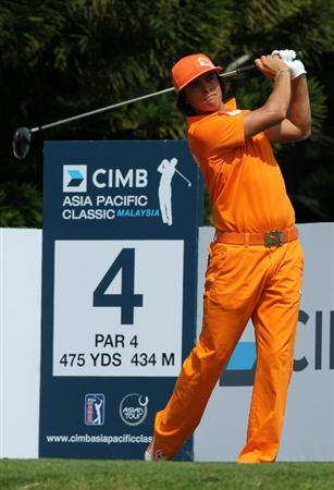 KUALA LUMPUR, MALAYSIA - OCTOBER 31: Rickie Fowler of USA follows through his tee shot on the 4th holeduring day four of the CIMB Asia Pacific Classic at The MINES Resort & Golf Club on October 31, 2010 in Kuala Lumpur, Malaysia. (Photo by Stanley Chou/Getty Images)