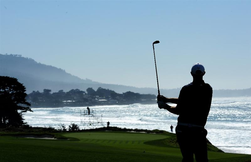 PEBBLE BEACH, CA - FEBRUARY 14:  Dustin Johnson plays his approach on the 10th hole during the final round of the AT&T Pebble Beach National Pro-Am at Pebble Beach Golf Links on February 14, 2010 in Pebble Beach, California.  (Photo by Stuart Franklin/Getty Images)