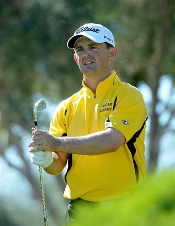 LAS VEGAS - OCTOBER 17: Greg Chalmers tees off the par three 8th hole during the third round of the Justin Timberlake Shriners Hospitals for Children Open at the TPC Summerlin on October 17, 2009  in Las Vegas, Nevada. (Photo by Marc Feldman/Getty Images)