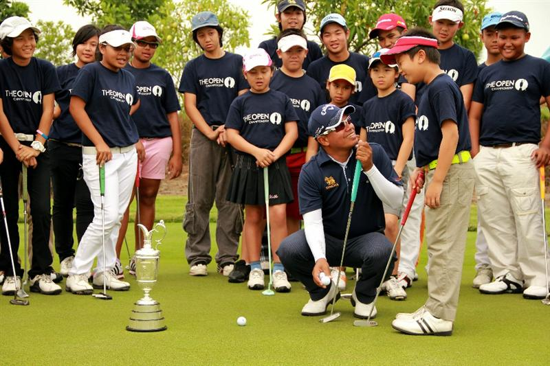 BANGKOK, THAILAND - FEBRUARY 23:   Prayad Marksaeng of Thailand instructs children during the R&A Junior Coaching Clinic at Amata Spring Country Club on February 23, 2011 in Bangkok, Thailand.  (Photo by Stanley Chou/Getty Images)