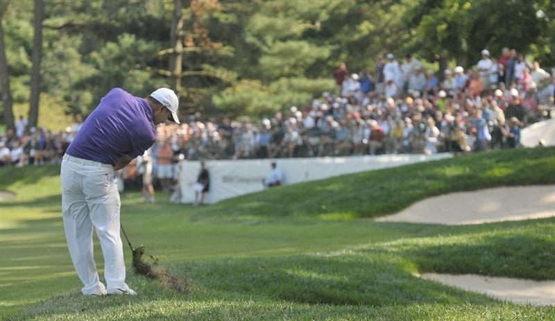 ST. LOUIS - SEPTEMBER 07 :  Anthony Kim hits his approach shot to the 15th hole  during the fourth and final round  of the BMW Championship held at Bellerive Country Club on September 7, 2008 in St. Louis, Missouri. (Photo by Marc Feldman/Getty Images)