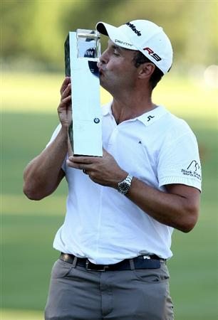 VIRGINIA WATER, ENGLAND - MAY 23:  Simon Khan of England kisses the trophy following his victory at the end of the final round of the BMW PGA Championship on the West Course at Wentworth on May 23, 2010 in Virginia Water, England.  (Photo by Ross Kinnaird/Getty Images)
