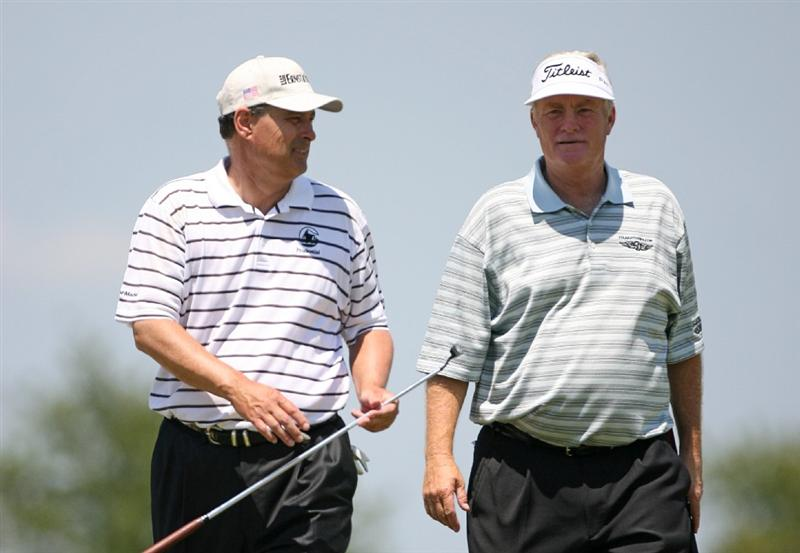 SAVANNAH, GA - APRIL 25:  Playing partners Mark Wiebe (L) and Loren Roberts (R) walk off the 18th green during the second round of the Liberty Mutual Legends of Golf at the Westin Savannah Harbor Golf Resort and Spa on April 25, 2009 in Savannah, Georgia. (Photo by Hunter Martin/Getty Images)