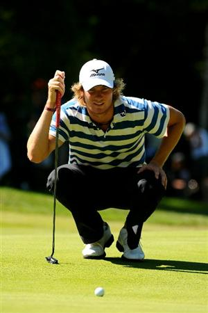VIRGINIA WATER, ENGLAND - MAY 23:  Chris Wood of England lines up a putt on the 4th green during the final round of the BMW PGA Championship on the West Course at Wentworth on May 23, 2010 in Virginia Water, England.  (Photo by Richard Heathcote/Getty Images)