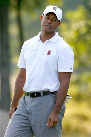NORTON, MA - SEPTEMBER 5:  Tiger Woods reacts after a missed birdie during the second round of the Deutsche Bank Championship held at TPC Boston on September 5, 2009 in Norton, Massachusetts. (Photo by Jim Rogash/Getty Images)