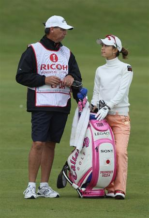 LYTHAM ST ANNES, ENGLAND - JULY 30:  Momoko Ueda of Japan prepares to hit her second shot on the 2nd hole during the first round of the 2009 Ricoh Women's British Open Championship held at Royal Lytham St Annes Golf Club, on July 30, 2009 in  Lytham St Annes, England.  (Photo by David Cannon/Getty Images)