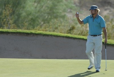 Ryan Moore salutes the gallery on the 15th hole during the fourth and final round of the Fry's Electronics Open on October 21, 2007at the Grayhawk Golf Club in Scottsdale, Arizona PGA TOUR - 2007 Frys Electronics Open - Final RoundPhoto by Marc Feldman/WireImage.com