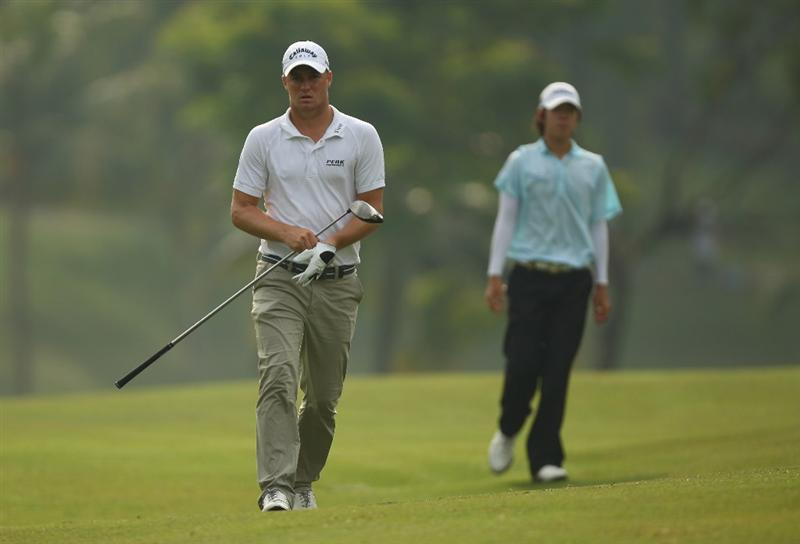KUALA LUMPUR, MALAYSIA - FEBRUARY 12:  Alexander Noren of Sweden(L) and Seung-yul Noh of Korea walk up the 18th hole during the first round of the 2009 Maybank Malaysian Open at Saujana Golf and Country Club on February 12, 2009 in Kuala Lumpur, Malaysia.  (Photo by Ian Walton/Getty Images)