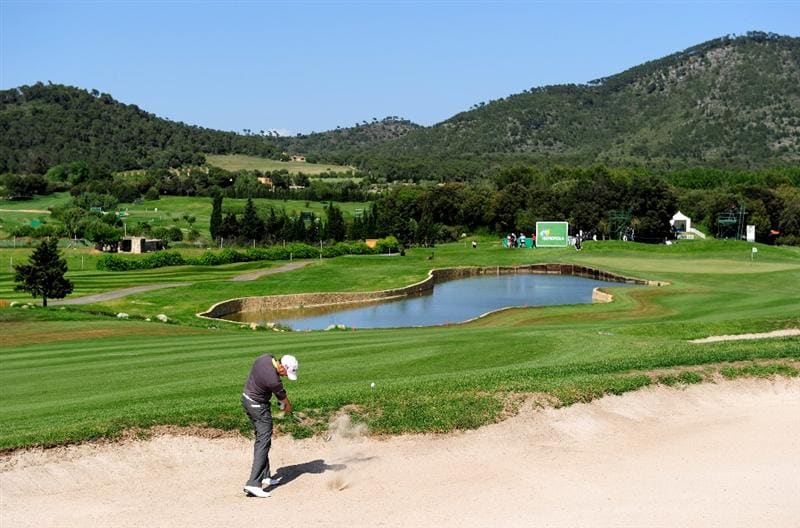MALLORCA, SPAIN - MAY 15:  Andrew Marshall of England plays his bunker shot on the 16th hole during the third round of the Open Cala Millor Mallorca at Pula golf club on May 15, 2010 in Mallorca, Spain.  (Photo by Stuart Franklin/Getty Images)