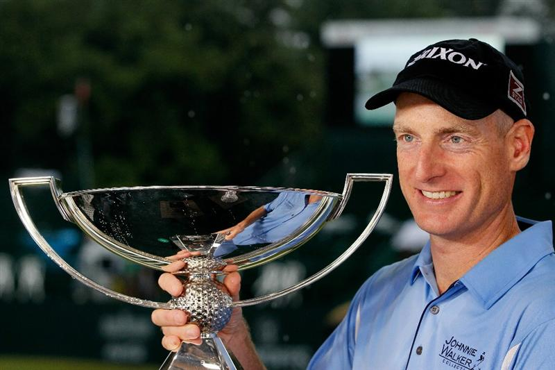 ATLANTA - SEPTEMBER 26:  Jim Furyk celebrates with the FedExCup Trophy after winning THE TOUR Championship presented by Coca-Cola, the final event of the PGA TOUR Playoffs for the FedExCup, at East Lake Golf Club on September 26, 2010 in Atlanta, Georgia.  (Photo by Kevin C. Cox/Getty Images)