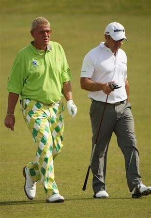 TURNBERRY, SCOTLAND - JULY 16:  John Daly of USA walks with Paul McGinley of Ireland walk together on the 8th hole during round one of the 138th Open Championship on the Ailsa Course, Turnberry Golf Club on July 16, 2009 in Turnberry, Scotland.  (Photo by Warren Little/Getty Images)