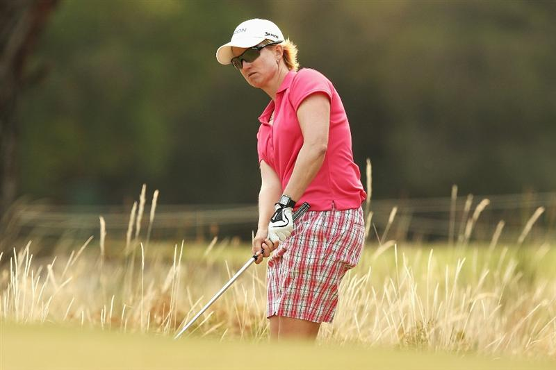 MELBOURNE, AUSTRALIA - FEBRUARY 13:  Karrie Webb of Australia plays out of the rough on the thirteenth hole during day two of the 2009 Women's Australian Open held at the Metropolitan Golf Club February 13, 2009 in Melbourne, Australia.  (Photo by Quinn Rooney/Getty Images)
